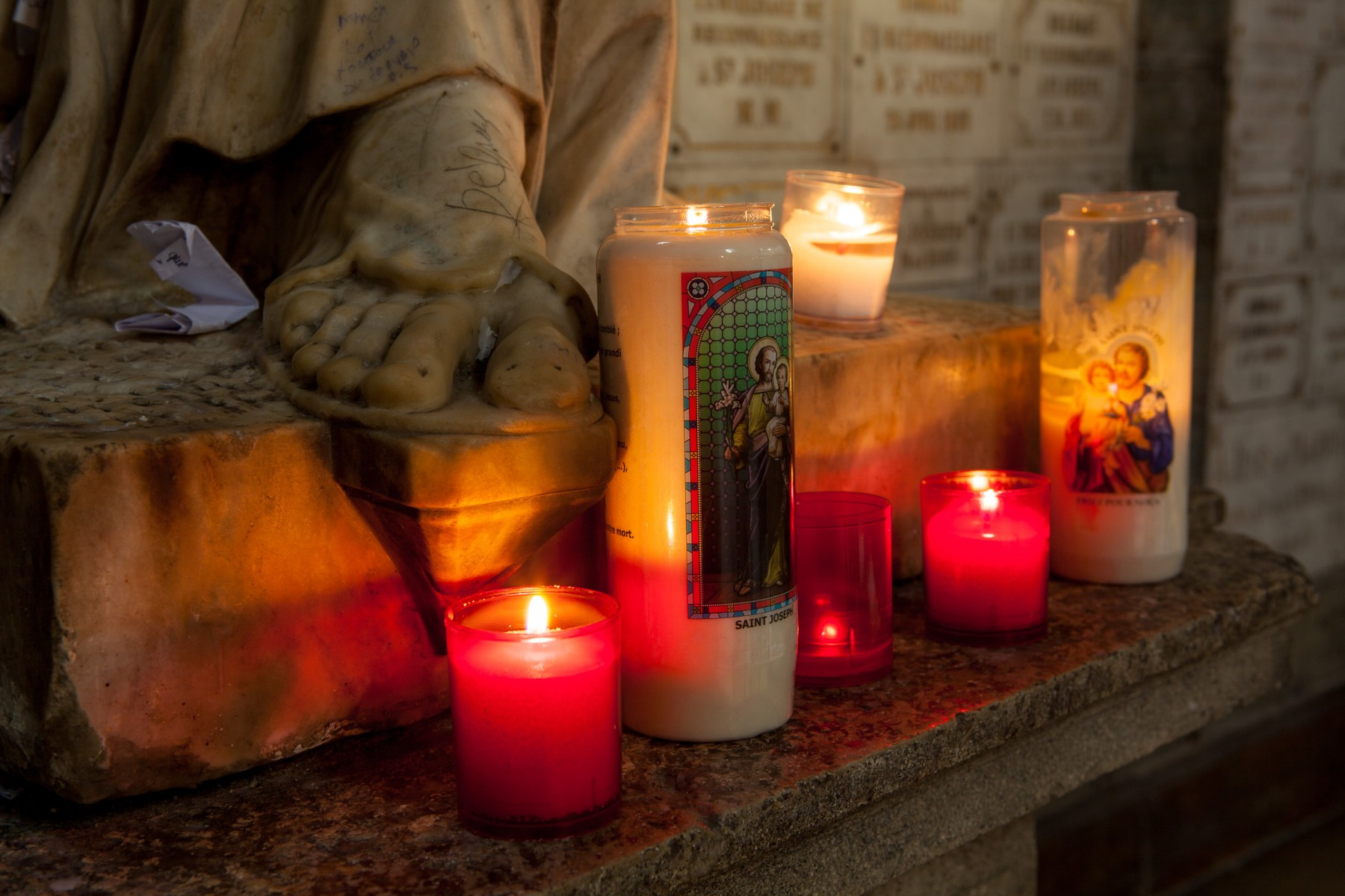 Offerings at the feet of St Joseph in Saint-Sulpice, Paris.