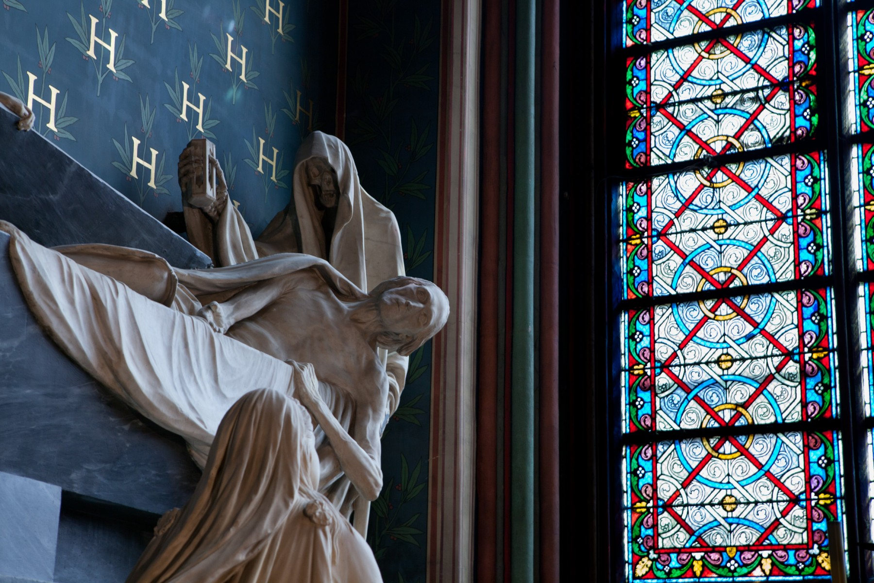 Sculpture of death in Notre Dame.