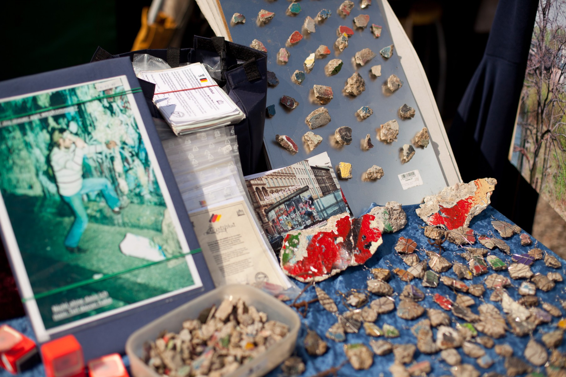 Fragments of the Berlin Wall on sale at a market stall