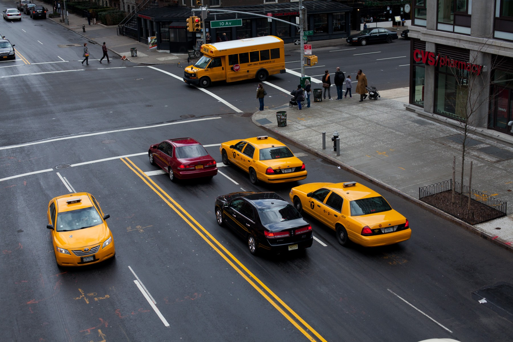 Yellow Cabs at an intersection in NYC