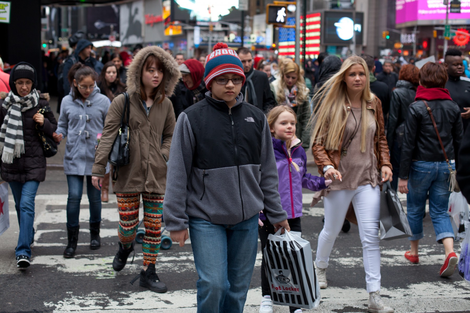 Crowds at a pedestrian crossing in New York City's Times Square