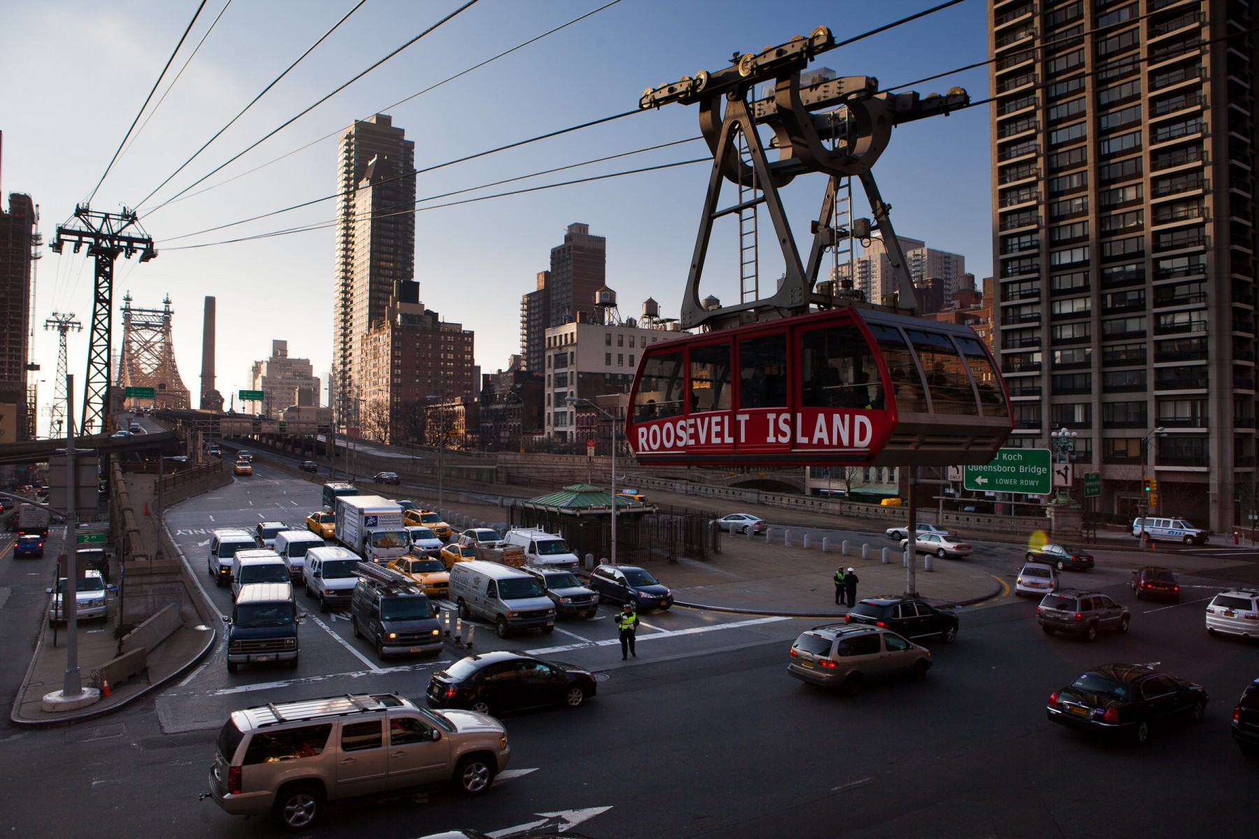 The Roosevelt island aerial tram running parallel with the Queensboro Bridge in NYC.
