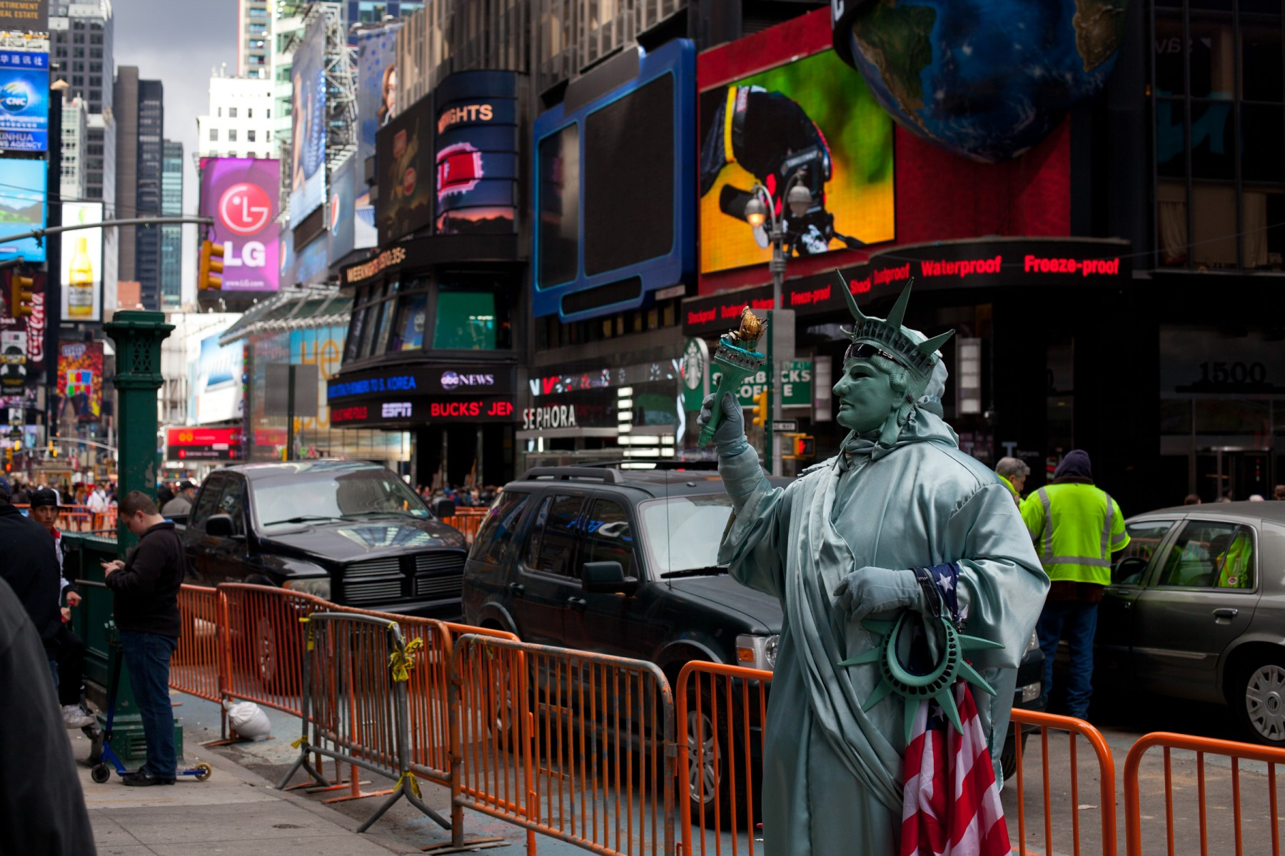 A very patriotic looking Lady Liberty poses for the camera in times Square, NYC.