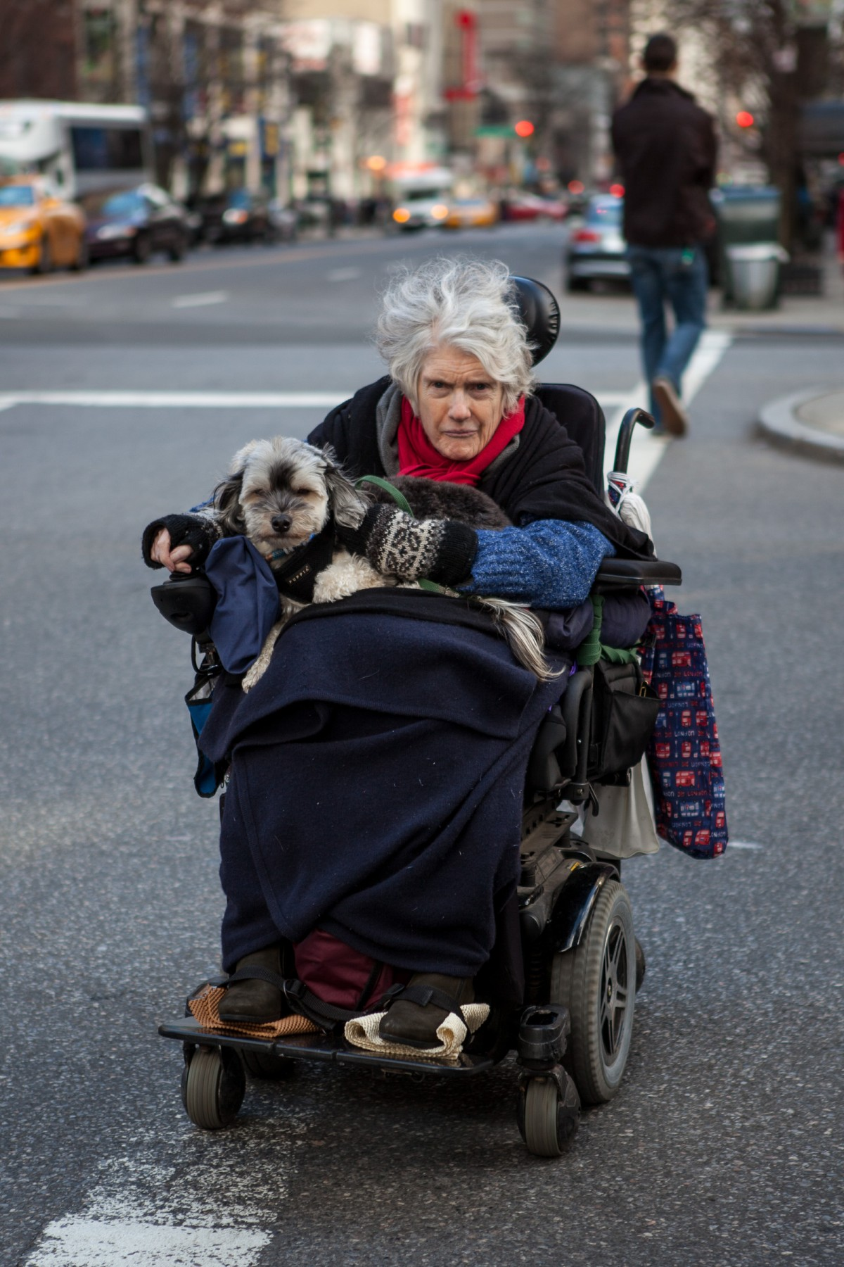 Old lady crossing the road in New York City