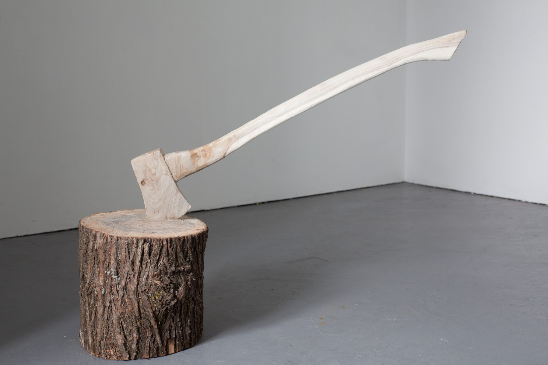 2009 work by Nicole Breedon Weeping willow (one piece) Approx. 120x40x100cm Chopping Block Paradox is a rough-cut tree trunk penetrated by a to-scale traditional, wooden handled axe, the entire piece hewn from a single piece of weeping willow. Instead of spitting it in two, the log becomes the axe's captor. Once unified, this natural pair of objects becomes stripped of purpose