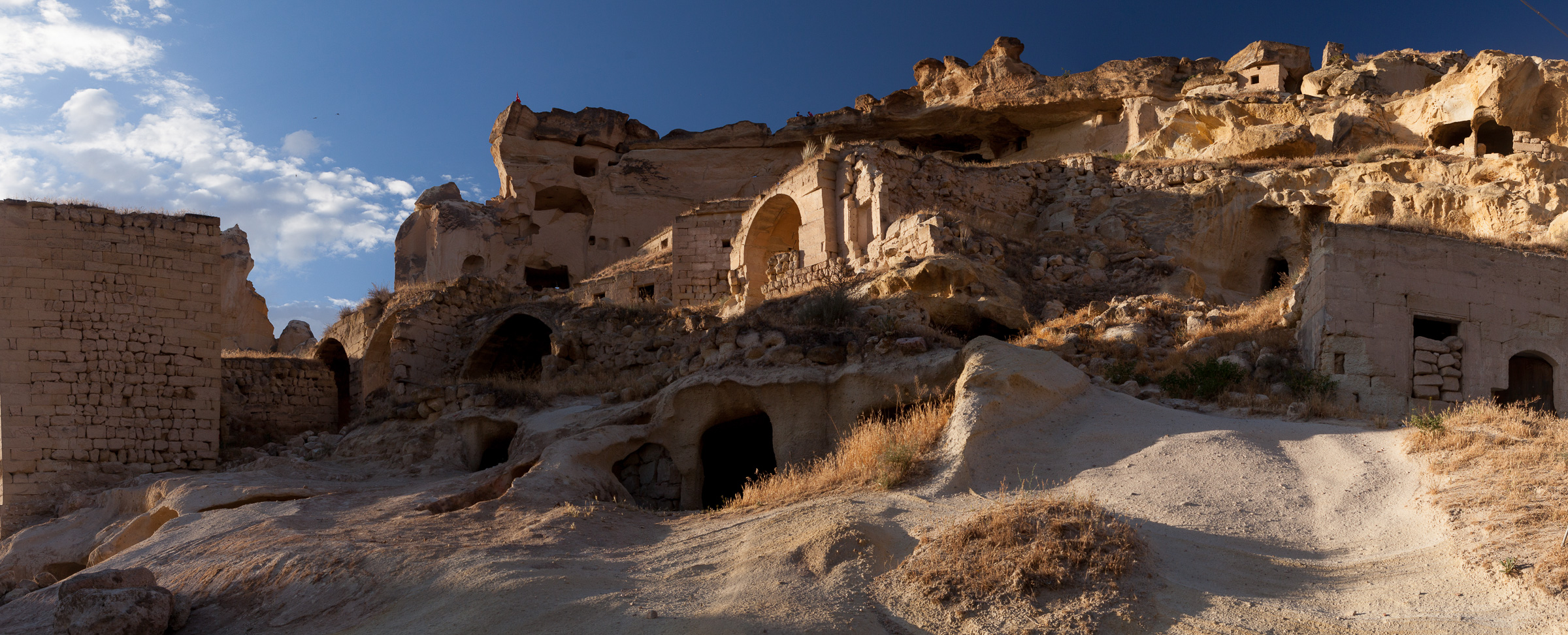 A panorama of the cliffs over Çavuşin in Cappadocia