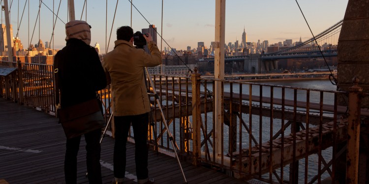 Two men shoot the sunrise from Brooklyn Bridge, NYC