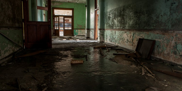 Hallway inside St. Agnes high school in Detroit.  Ice and debris cover the floor.