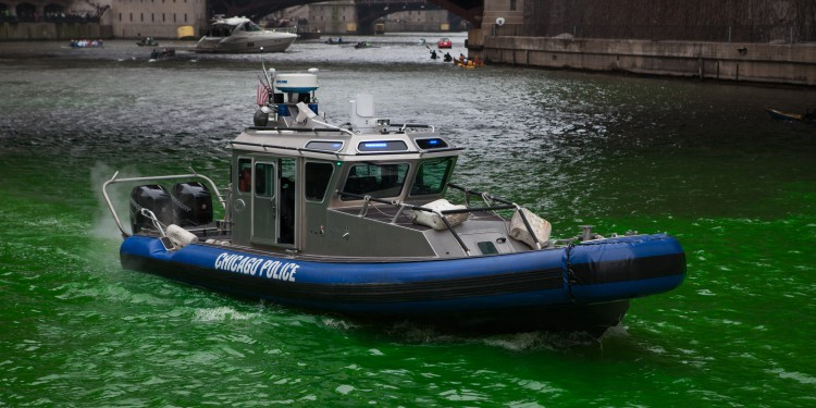 A police boat patrols the Chicago river during St Patrick's day celebrations 2013.