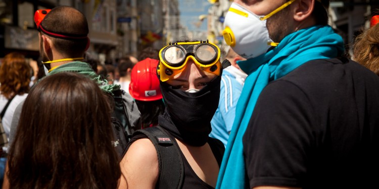 Protesters wearing makeshift masks and eye wear participating in anti-government demonstrations in Istanbul.