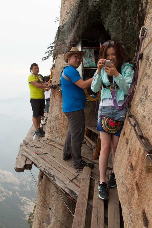 Tourists on the  plank path on the south peak of Mt Huashan