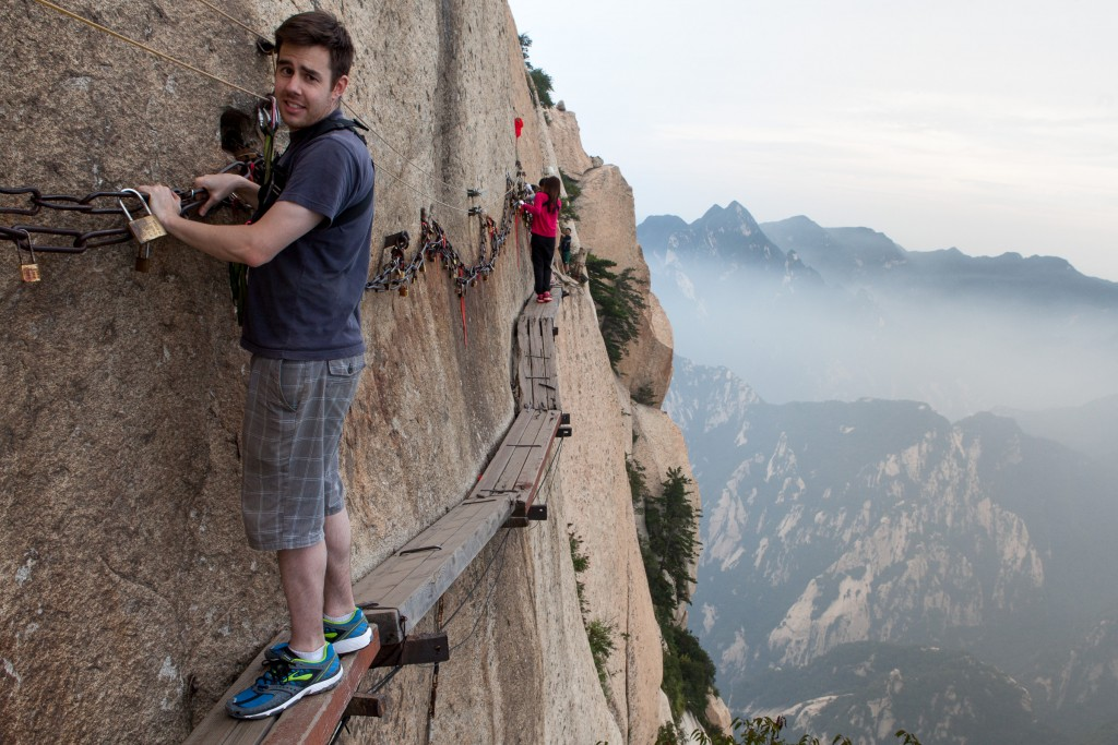 Andrew on the The plank path which is made up of ancient steel pins driven into the cliff supporting timber planks held togther with wire and more steel pins. Hua Shan is classified as having five main peaks, of which the highest is the South Peak at 2,154.9 meters