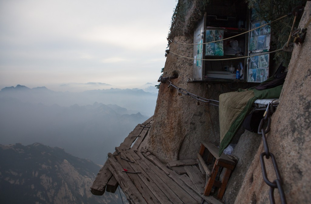 The tiny photo booth built into the wall of the Cliffside Plank path on the south peak of Mt Huashan.  Below is a thousand meter drop.