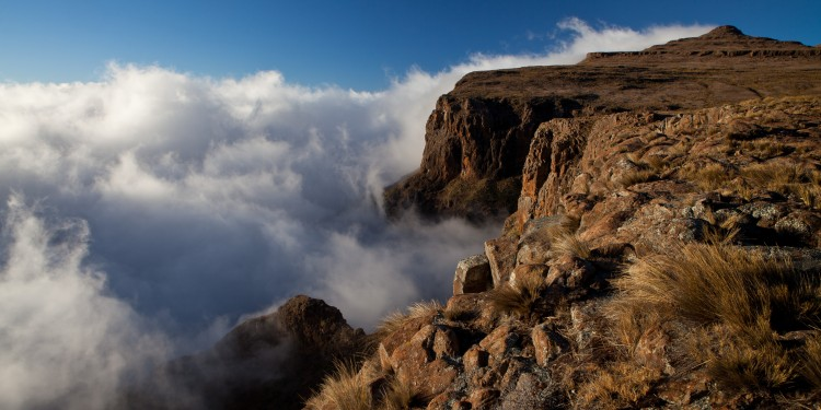 Clouds lifting up from the valley at sunrise in Lesotho.