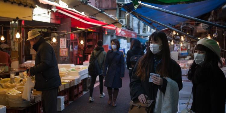Customers browsing the stalls for fresh seafood at the Tsukiji fish market.