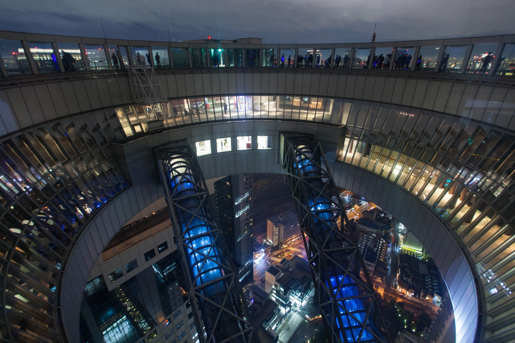 The atrium between the two towers of the Umeda Sky Building in Osaka.  You can see the enclosed 'pipes' that house the escalators that allow visitors to come and go from the observation deck.