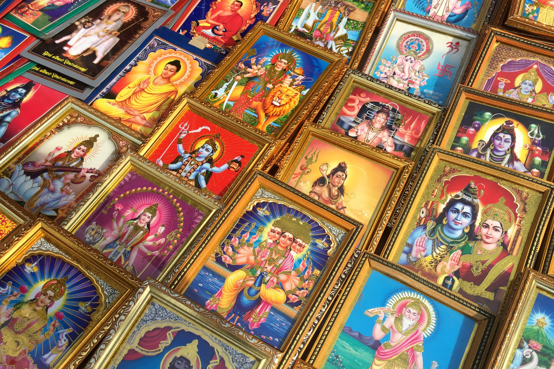 Framed icons of the Hindu deities at a market stall in Anuradhapura.