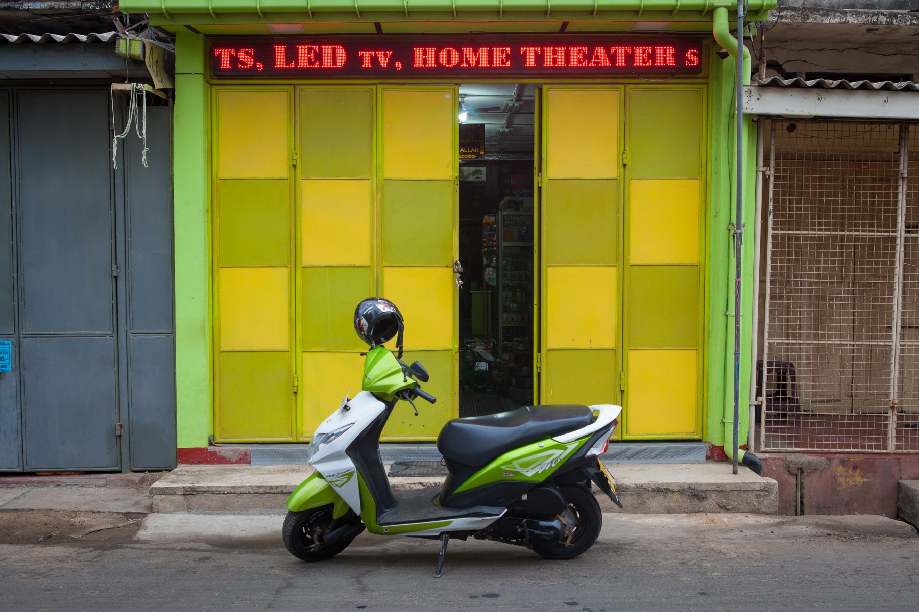 Colour coordinated scooter and shopfront in Puttallam on the west coast of Sri Lanka.