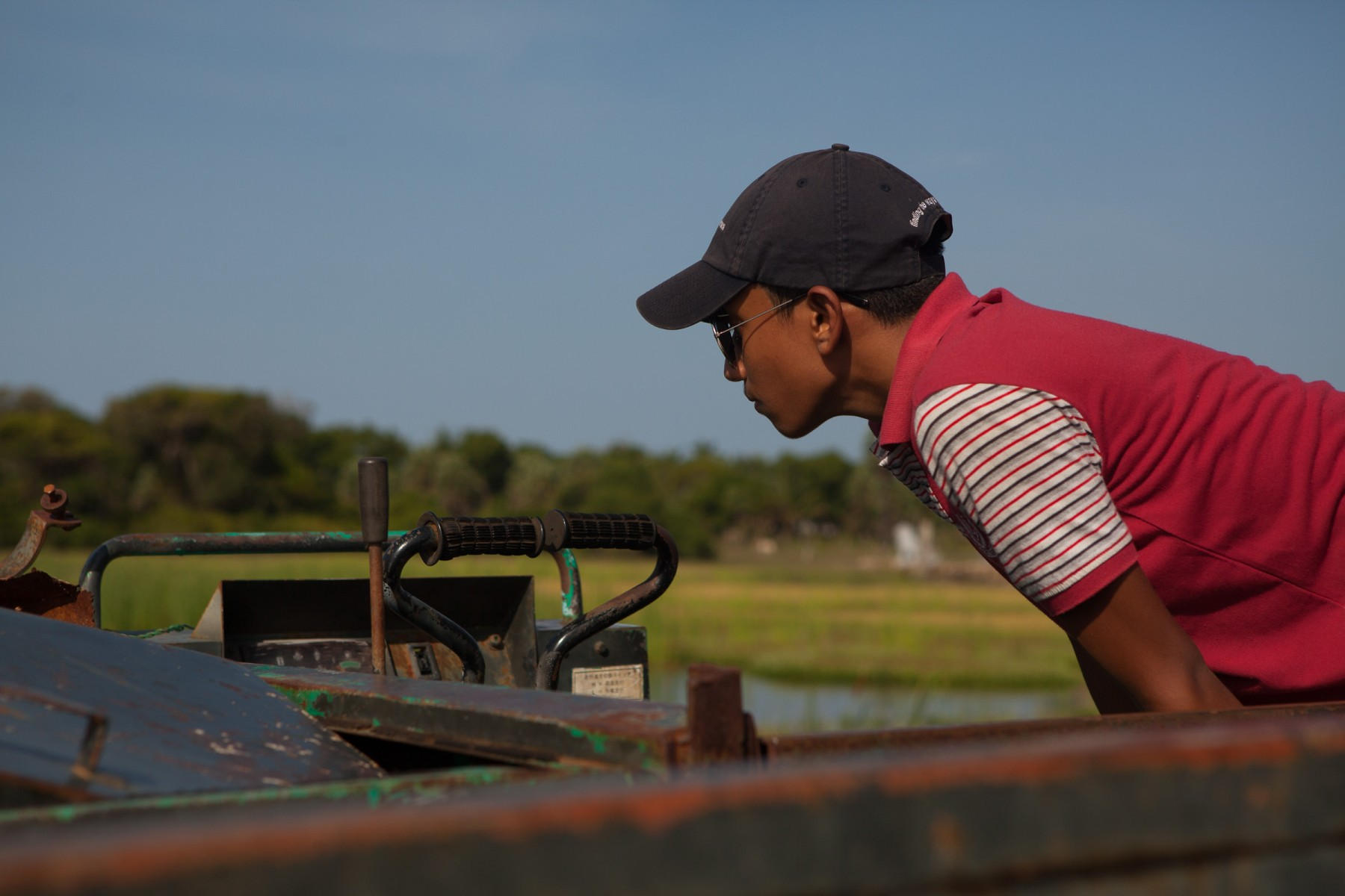 A young Sri Lankan boy inspects an attack boat used by the LTTE's navy during the Sri Lankan civil war.