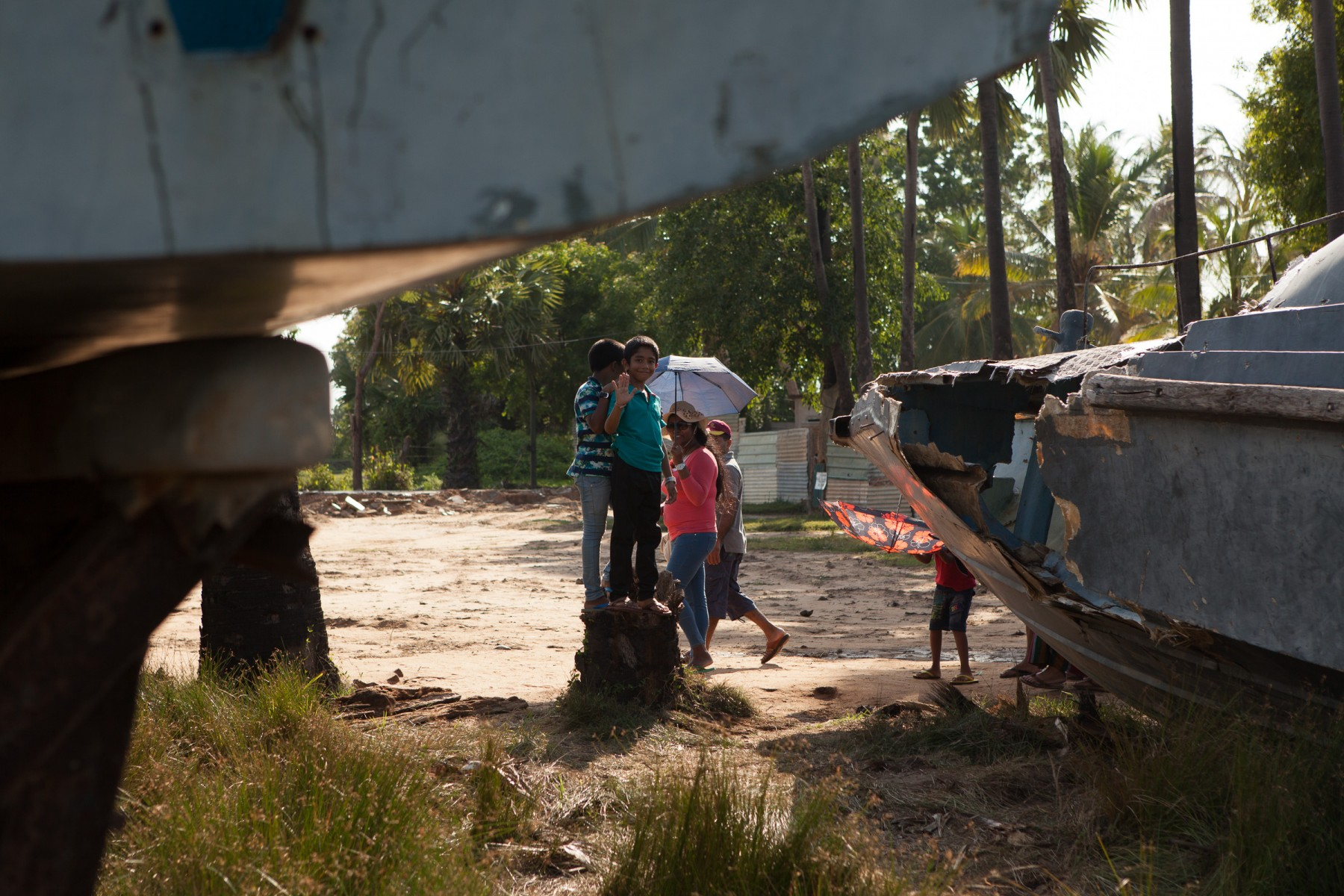 Local tourists take in the sight of 'Sea Tiger' ships in an open-air museum near Mullaitivu in northern Sri Lanka.