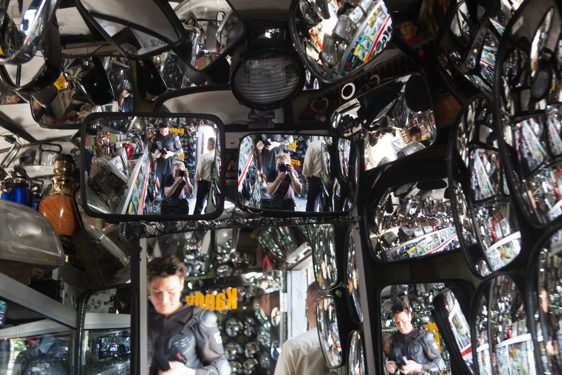 A crapload of wing mirrors in a Kandy auto supply store.