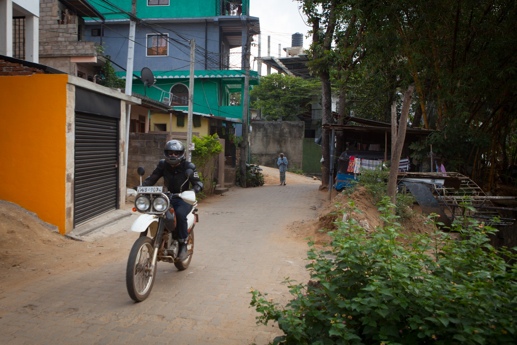 Ryan rides through the colourful streets of Kandy.