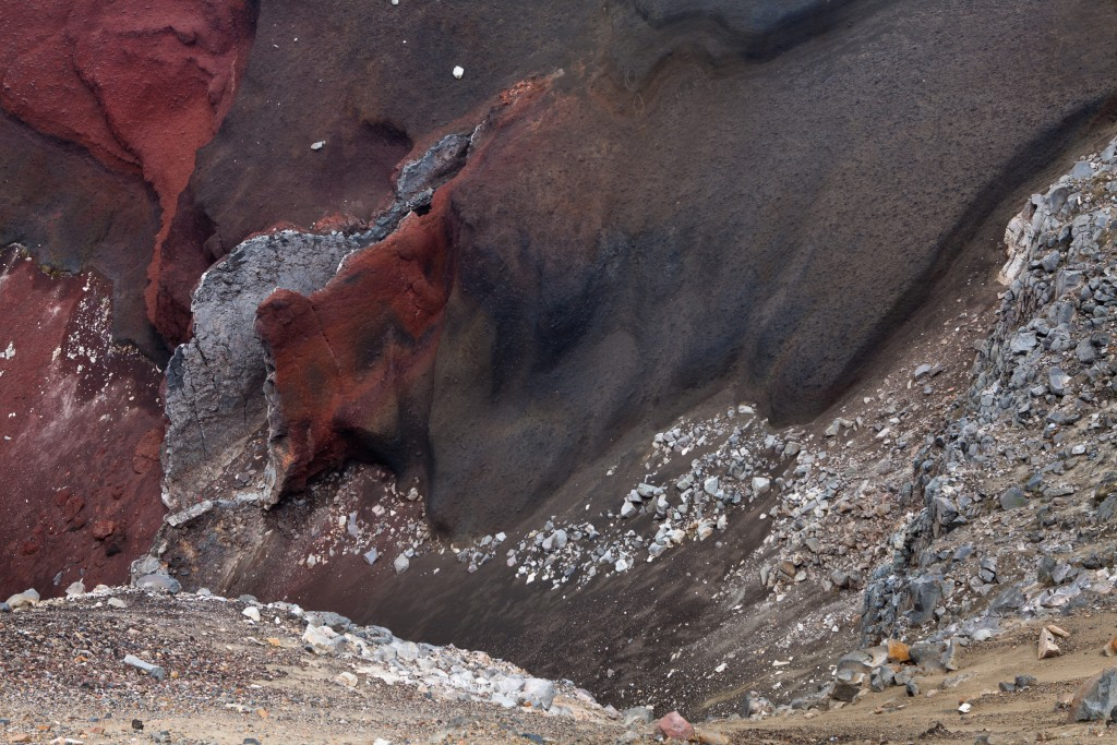 The exposed lava tube inside Red Crater.  The colour of the crater walls is due to extreme heat oxidising the iron content of the rocks.