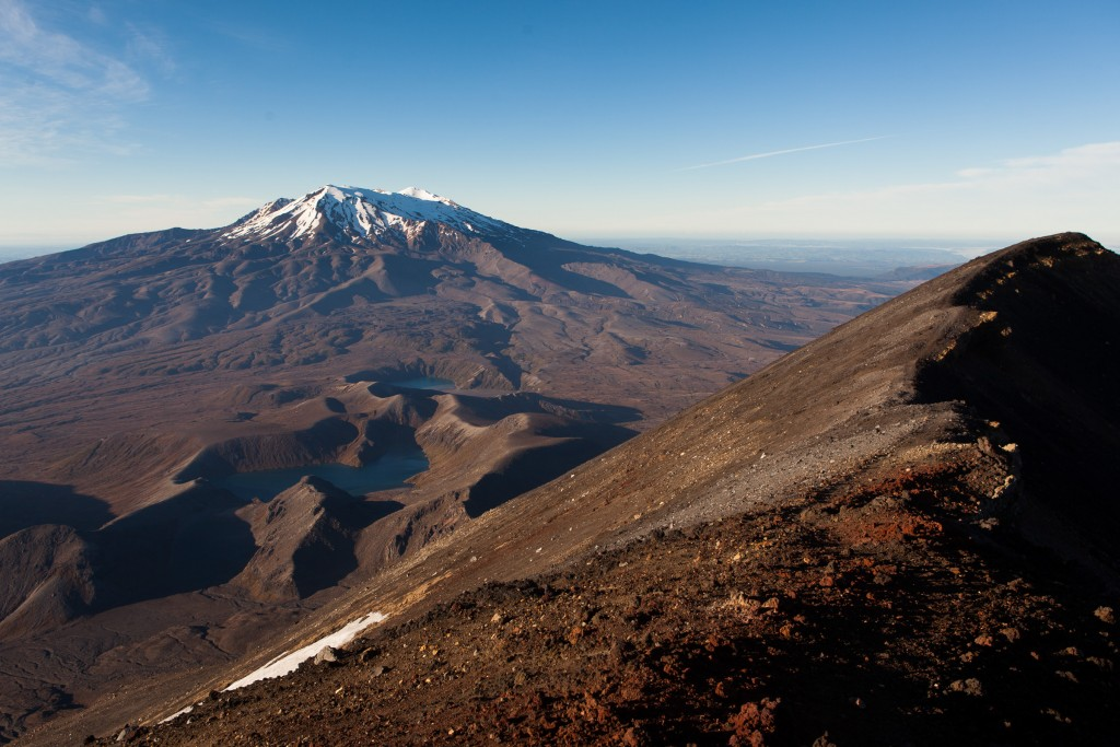 View of Mount Ruapehu from the edge of the cinder cone of Mount Ngauruhoe.  Ruapehu is an active volcano with a highest peak of 2,797 m