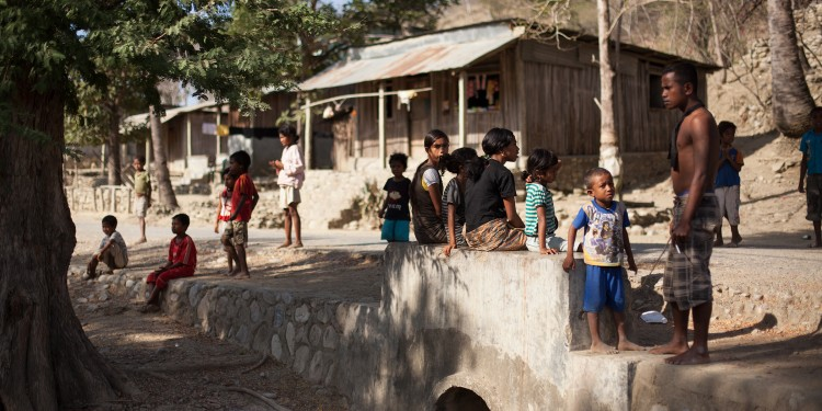 Families gathered by the side of the road in Cova Lima district on the south coast of East timor.