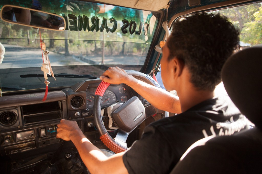 One of the assistants from the school in Zumalai behind the wheel of a Toyota Landcruiser- a mainstay of transport in the rural areas.