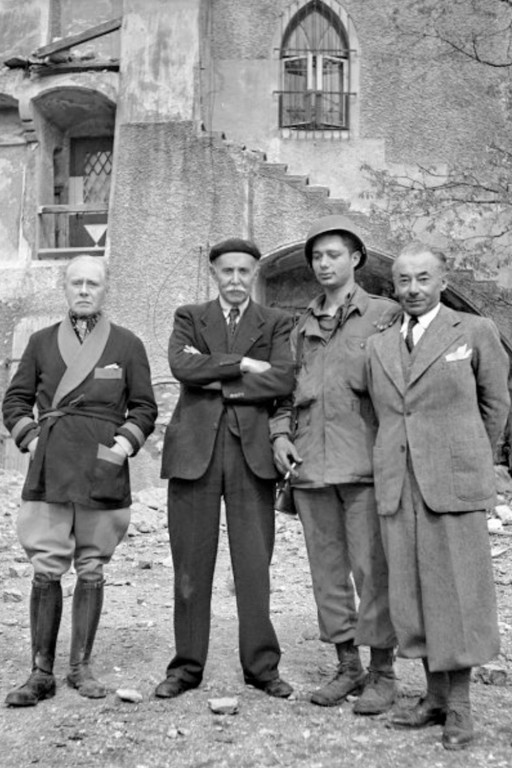 From left: Maurice Gamelin, Michel Clemenceau, unknown GI and Paul Reynaud.