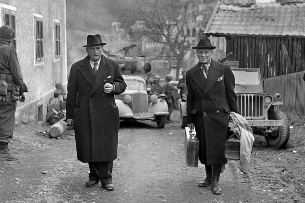 Edouard Daladier and General Maurice Gamelin leave Itter castle on May 5, 1945, after Itter was liberated by a mixed force of US and German army troops. Daladier had supported appeasement policies and signed the Munich Pact in 1938. He was ousted from his position as prime minister by Paul Reynaud.