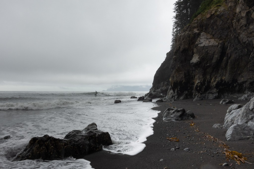 Black sand and white foam on Julio's beach break at the end of the Kenai Peninsula.