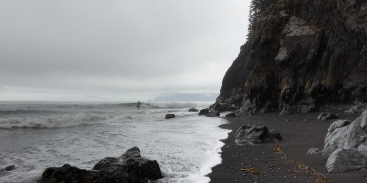 Black sand and white foam on Julio's beach break at the end of the Kenai Peninsula.