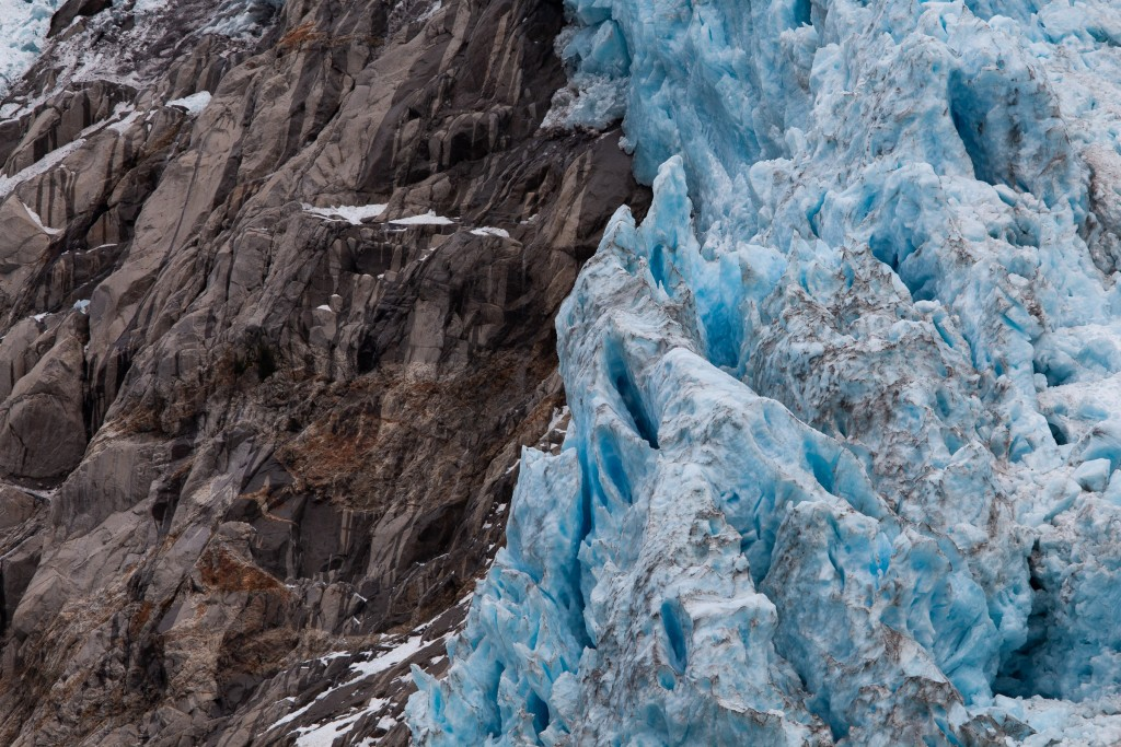 Ice clinging to exposed rock above Northwestern Fjord.