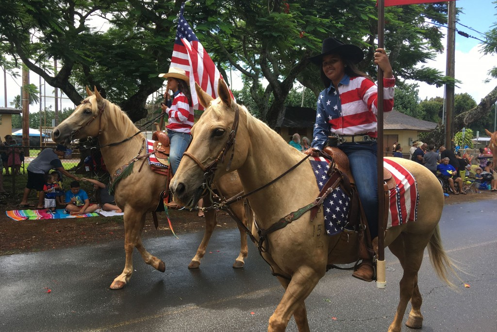 Women on horseback as part of Kauai's Annual Historic Koloa Plantation Days Parade. The festival takes place over ten days and celebrates the cultural diversity of the early immigrants that worked in  Hawaii's sugar plantations in the early 19th century.