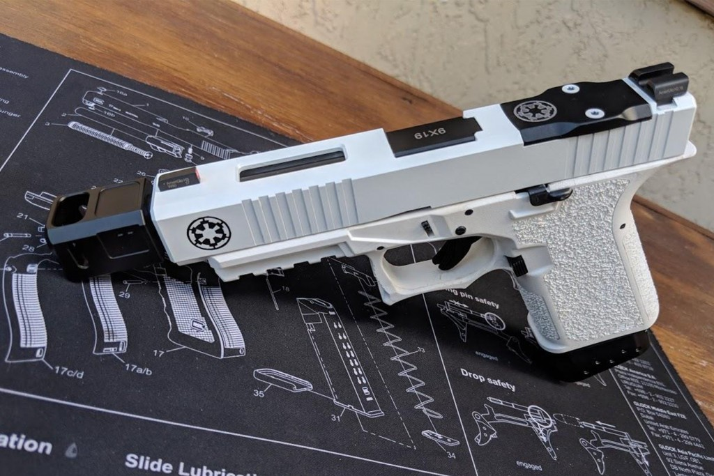 An actual Glock pistol with a stormtrooper colour-scheme. This was posted on The Empire Did Nothing Wrong subreddit and you have to scroll for a really long time before you find anyone suggesting that it might not be a good idea to make a real gun look like a toy.