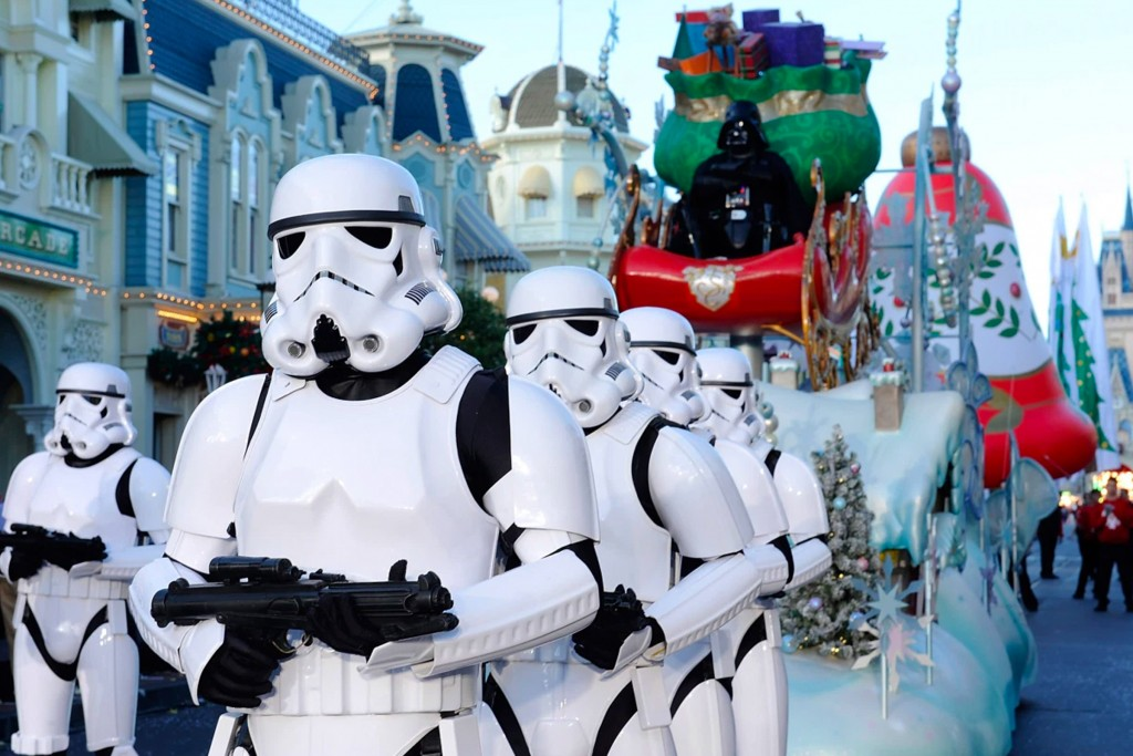 A Christmas-themed stormtrooper parade down main street in Disneyland Anaheim, California. Disney acquired the rights to Star Wars in 2012 for $4.05 billion US.
